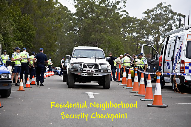 image of vehicle checkpoint guarding entrance of residential street