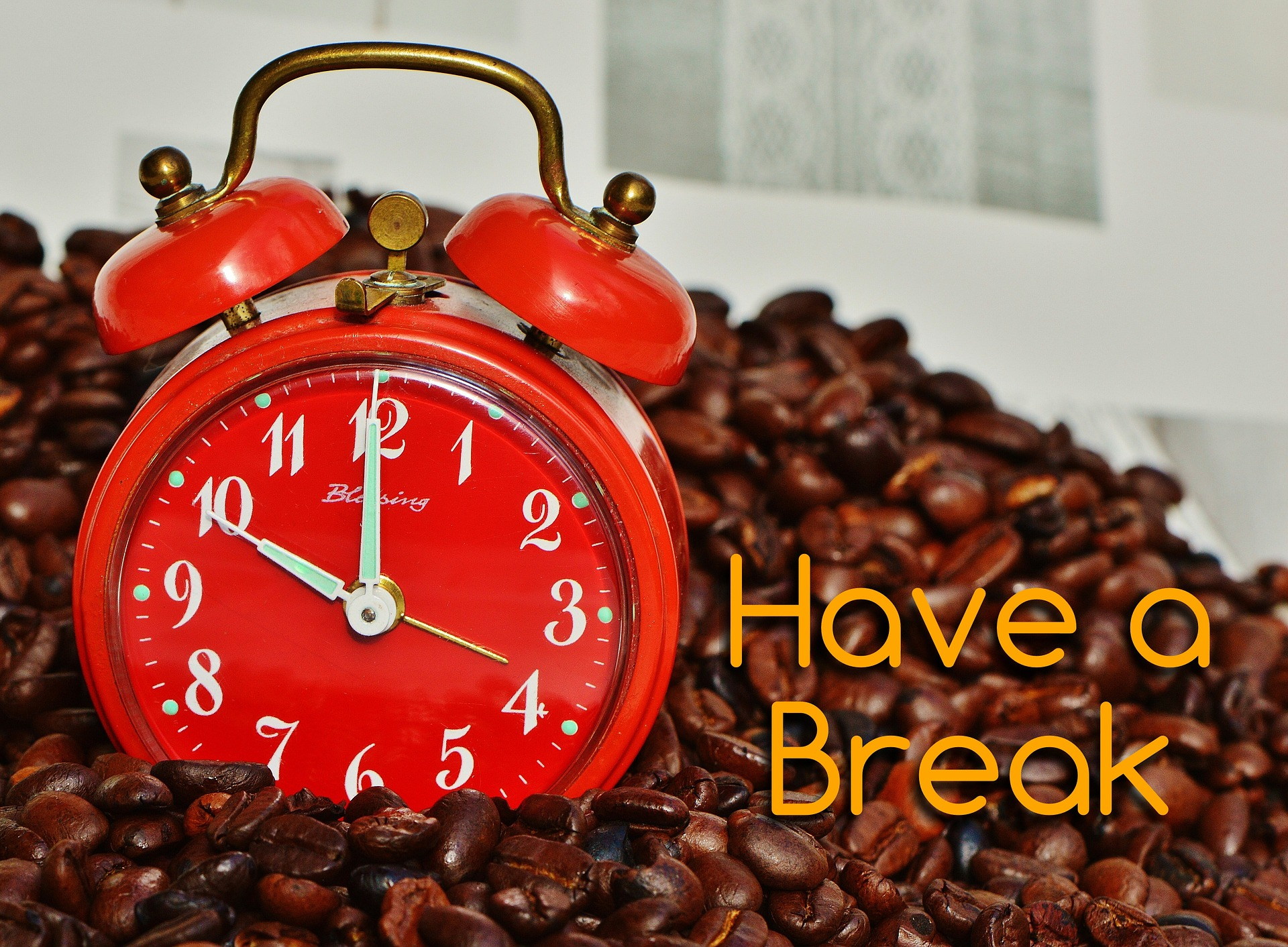 Image of coffee beans, a clock, and the words Have a Break