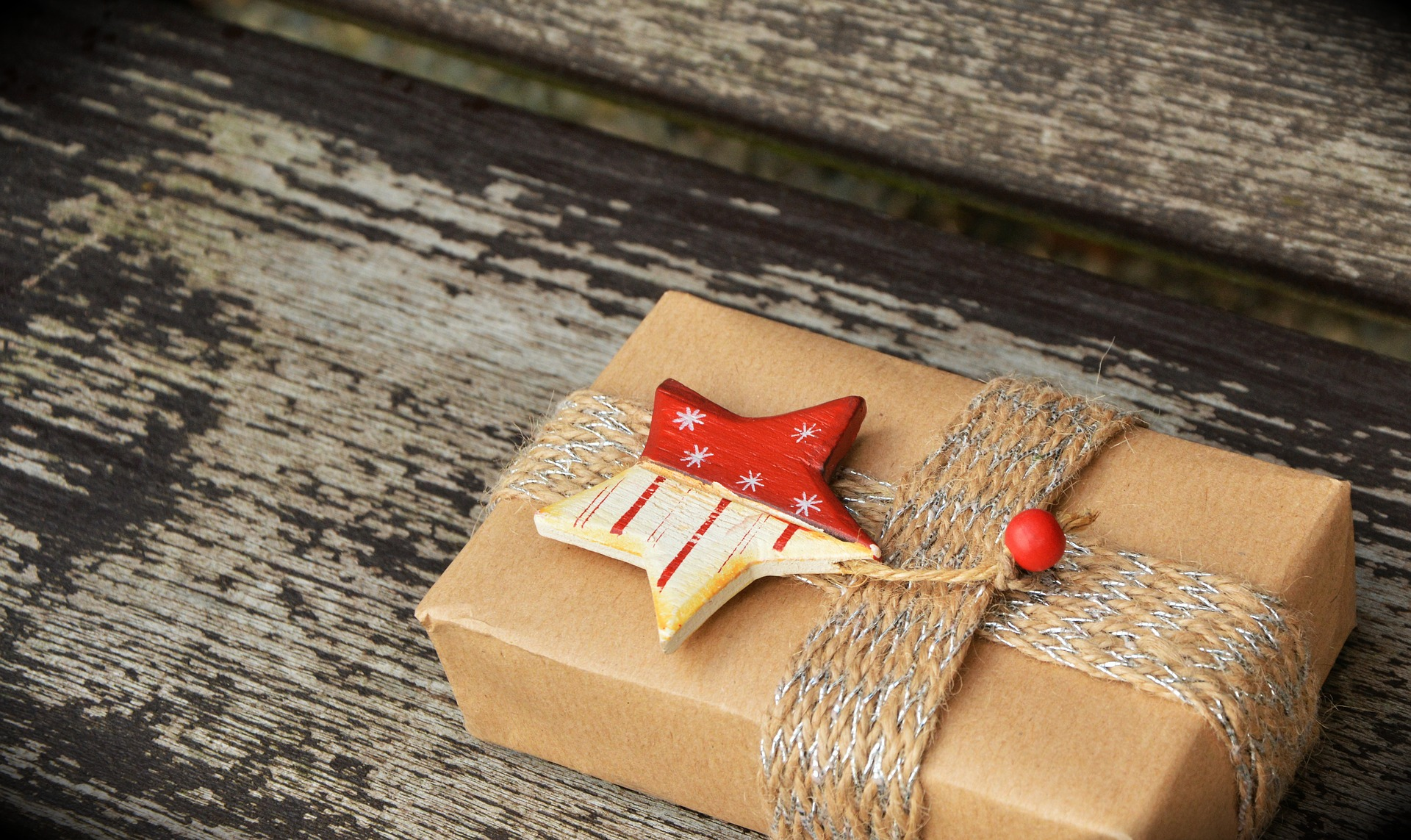 Image of package on porch, wrapped as gift